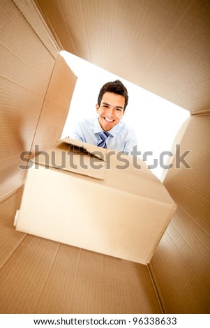 Businessman getting a special delivery and smiling - stock photo