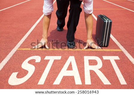 businessman getting ready for race on the track - stock photo
