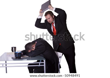 Businessman Getting Rid of His Competition - stock photo