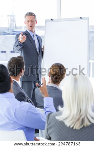 Businessman give a presentation in a meetingroom - stock photo