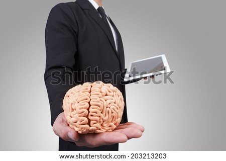 businessman give the brain in concept  for successful business - stock photo
