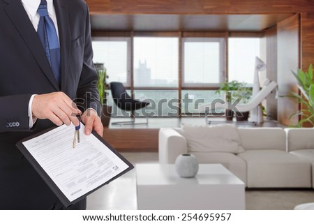 Businessman gives keys for the contract - stock photo