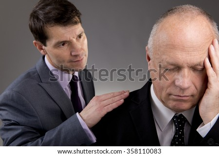 Businessman Gives Sympathy - stock photo