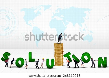 Businessman giving a command from a pile of golden coins on his employees to create a solution  - stock photo