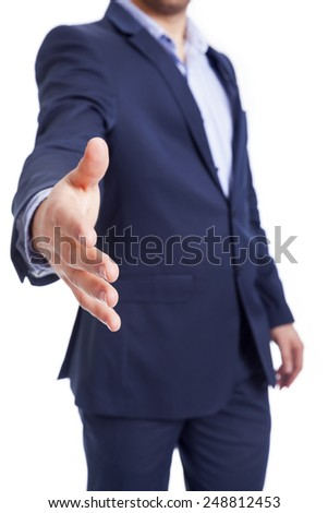 Businessman giving his hand, isolated on white background - stock photo