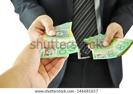 Businessman giving money - Australian Dollar Bills - stock photo