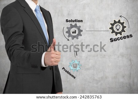 businessman giving thumbs up sign and drawing gears and cogs - stock photo
