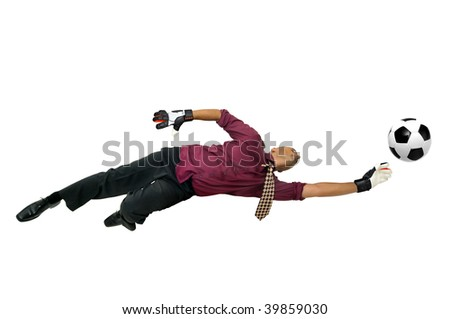 Businessman goalkeeper with gloves  in a acrobatic pose with a soccer ball isolated in white - stock photo