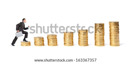 Businessman goes up the gold coins on a white background - stock photo