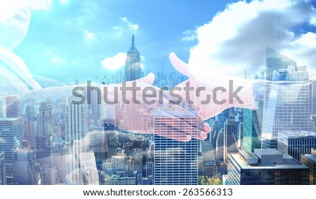 Businessman going shaking a hand against city skyline - stock photo