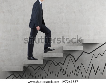 Businessman going up and line graphs. - stock photo