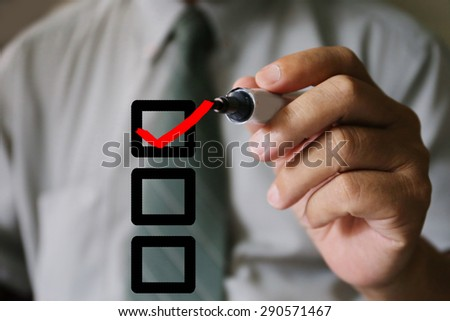 businessman hand check correct - stock photo