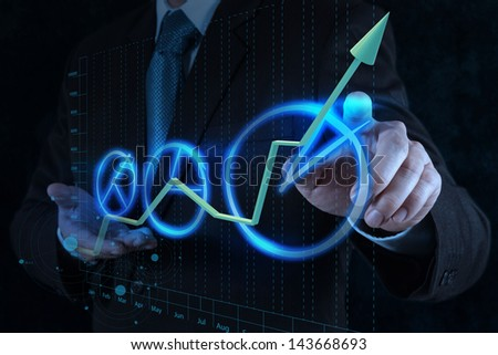 businessman hand drawing a pie chart on touch screen interface - stock photo