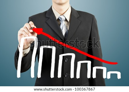businessman hand drawing chart graph - stock photo