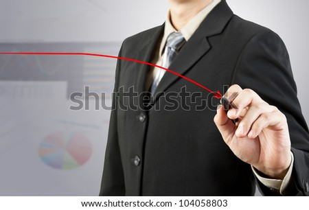 businessman hand drawing chart red down arrow - stock photo