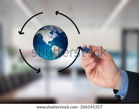Businessman hand drawing circle around Globe. Communication concept. Isolated on office. Stock Image - stock photo