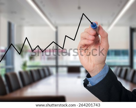 Businessman hand drawing graph of growth. Isolated on office background. Stock Image - stock photo