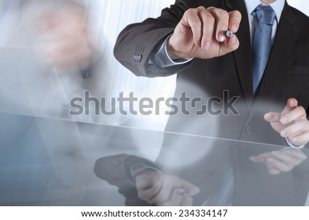businessman hand drawing on touchscreen computer  - stock photo