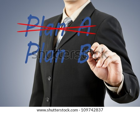businessman hand drawing plan a plan b - stock photo