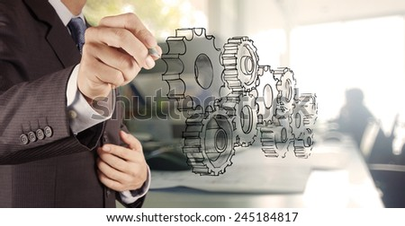 businessman hand draws gear to success concept - stock photo