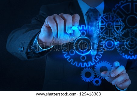 businessman hand draws gear to success concept on touch screen computer - stock photo