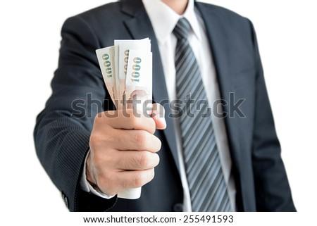 Businessman hand grabbing money, Thai Baht (THB) - isolated on white background - stock photo