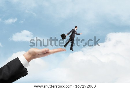 businessman hand halped to jump to businessman - stock photo