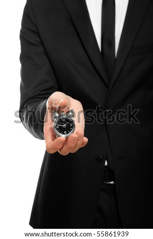businessman hand holding a small alarm clock, isolated on white - stock photo