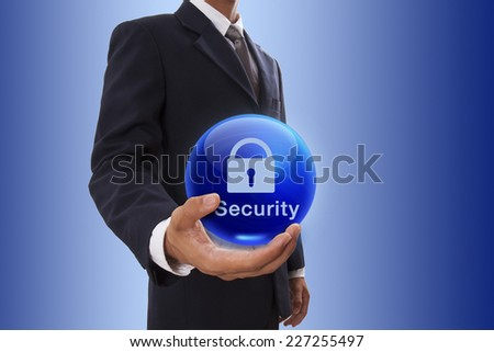 Businessman hand holding blue crystal ball with lock symbol. - stock photo