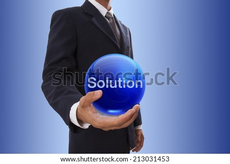 Businessman hand holding blue crystal ball with solution word.  - stock photo