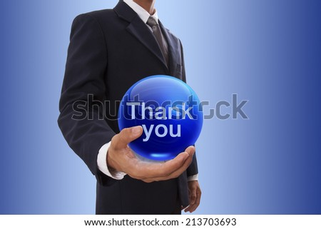 Businessman hand holding blue crystal ball with thank you word.  - stock photo