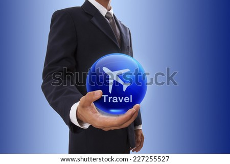 Businessman hand holding blue crystal ball with travel sign. - stock photo