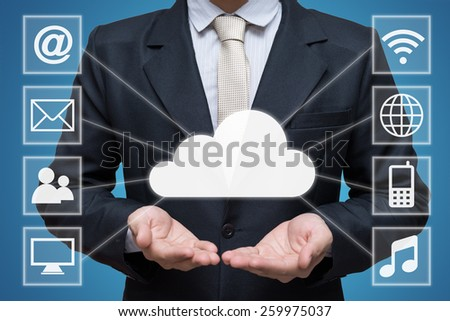 Businessman hand holding cloud computing network isolated on blue background - stock photo