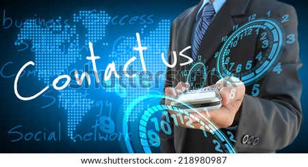 businessman hand holding contact us - stock photo