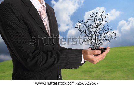 Businessman hand holding light bulb illustration idea concept - stock photo