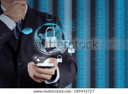 businessman hand holding mobile phone show padlock on touch screen computer as Internet security online business concept  - stock photo