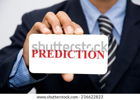 Businessman hand holding PREDICTION concept - stock photo