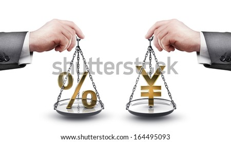 businessman hand holding Scale with procent symbols and symbols of currencies Yen  isolated on white background High resolution  - stock photo
