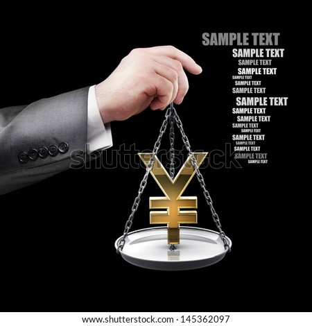 businessman hand holding Scale with symbols of currencies Yen isolated on black background  - stock photo