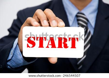 Businessman hand holding Start concept - stock photo