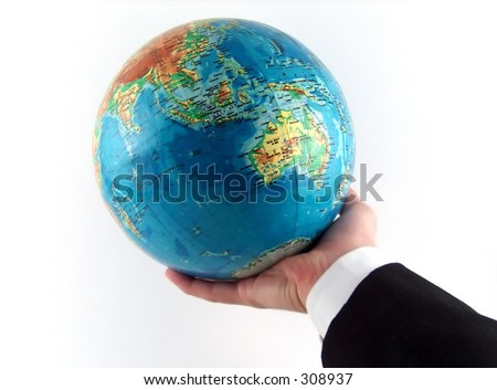 businessman hand holding the earth - stock photo