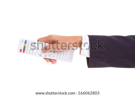 Businessman hand holding white remote control in hand isolated on white background  - stock photo