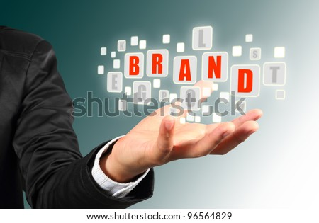 Businessman hand holding with red brand  alphabet streaming images - stock photo