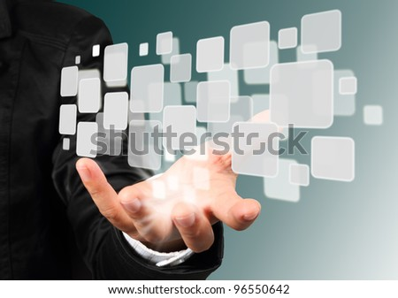 Businessman hand holding with streaming images - stock photo