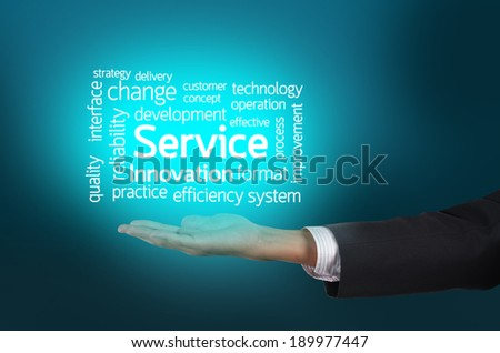Businessman hand holding word tags of Service - stock photo