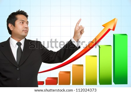 Businessman hand pointing arrows and graphs - stock photo