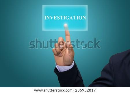 Businessman hand pointing INVESTIGATION - stock photo