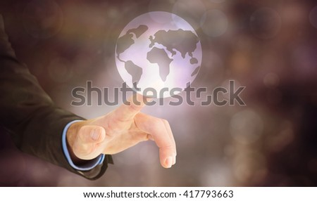 Businessman hand pointing something against earth - stock photo
