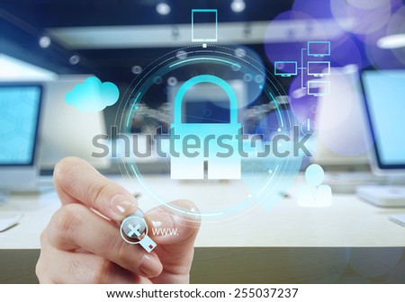 businessman hand pointing to padlock on touch screen computer as Internet security online business concept and bokeh exposure - stock photo