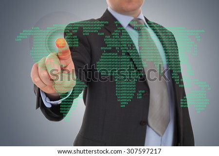 Businessman hand pointing with world map background - stock photo